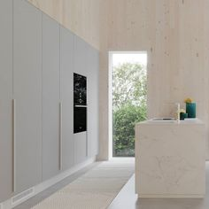 """Salla ARK on Instagram: """"Tämä CLT-seinään upotettu keittiö on ihan helmi 👌  #keittiö #vaaleakeittiö #nordicdesign #kitchendesign #clttalo #cltarkkitehti"""" Bathroom Lighting, Helmet, Garage Doors, Mirror, Outdoor Decor, Furniture, Instagram, Home Decor, Bathroom Light Fittings"""