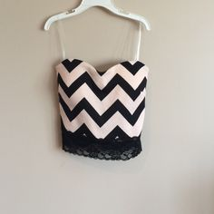 light pink and black crop top this one speaks for itself   pale pink with black stripes and a lace bottom trim . dress up with a pencil skirt or dress down with jean shorts , NWOT ! Fits like a s/m Charlotte Russe Tops Crop Tops
