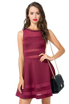 A naughty but nice flare dress featuring sheer mesh cutouts and chain embellished round neck. Sleeveless. Exposed back zip closure. Finished short hem. Scuba knit. $36.90