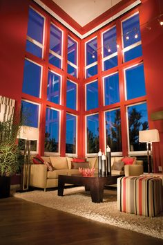 Modern Living Room: Stacked windows reach the ceiling against bold paint color.