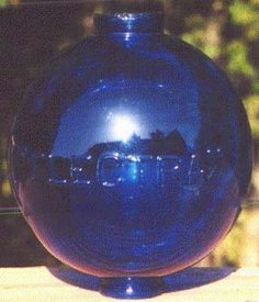 Antique Lightning Rod Ball Hall of Fame. Cobalt blue ball embossed ELECTRA with lightning bolts.