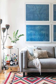 A Blank Canvas for Color, with Stacks of Secret Storage – Design*Sponge Mirror Above Couch, Blueprint Art, Secret Storage, Hidden Storage, Wall Decor, Room Decor, Room Art, Wall Spaces, Wood Wall Art
