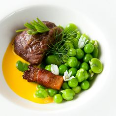 Braised Pork Cheek With Jowl Bacon Recipe Main Dishes with pork cheeks, salt, lard, sage leaves, sherry vinegar, unsalted butter, shallots, white wine, salt, heavy cream, saffron, lard, guanciale, peas, fava beans, chickpeas, onions, peas, fennel fronds