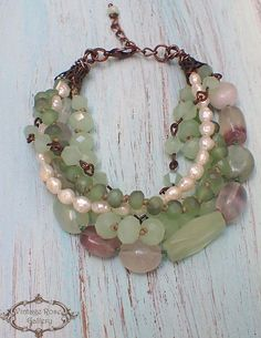 Boho chic Bracelet, Fluorite Bracelet, Aqua Multi Strand Bracelet, Green Bracelet, Gemstones Bracelet, Boho Bracelet A beautiful , One of a kind , 6 strands bracelet with different shades of light Green and semi - precious stones of rainbow fluorite , jade ,and rice freshwater #StrandBracelets #preciousstones
