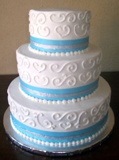 i like this cake, but instead of blue ribbon, purple to match the colour theme and would have the bride and groom on the top.