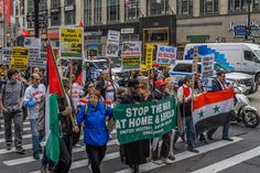 """Organized by United National Antiwar Coalition, anti-war, anti-racist and social justice activists gathered at Herald Square in New York City to say """"NO"""" to continued war and to demand money for human needs. Endless wars abroad mean austerity and militarized police at home."""