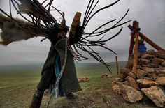Mongolian Shaman Gankhuyag Batmunkh dances in a trance during a Shaman ceremony by an 'ovoo' or 'sacred stone' site on Black Mountain Head in Nalaikh district of Ulan Bator in Mongolia, 06 July Photo and description by How Hwee Young Mongolia, Larp, Tibet, Wooly Bully, Witch Doctor, Spirit World, Samana, To Infinity And Beyond, People Of The World