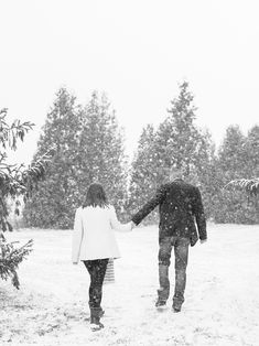 snowy winter engagement   windsor ontario   looks like film   black and white   photography