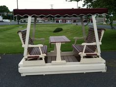 Saw this in Lancaster. The whole thing moves like a glider and you can take the table completely off. Outdoor Glider, Gliders, Porch Swing, Outdoor Furniture, Outdoor Decor, Yard, Lancaster, Jessie, Diy