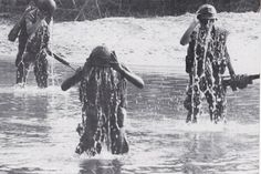 A patrol of Marines cool off with a helmet full of river water. ~ Vietnam War