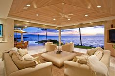 BEAUTIFUL view from an oceanfront house in Maui, Hawaii. House has private pool and sits on a secluded sandy beach with over 160 feet of ocean frontage, custom design and finishes, two-car garage, and central air conditioning.