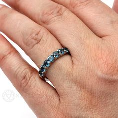 Stunning London Blue Topaz sparkles in this seven stone anniversary band. This ring is available in your choice of 14K or 18K White, Yellow or Rose