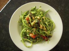 Zucchini ribbons with pesto. The no carb pasta!  Use whatever sauce you like.   http://www.welikeitraw.com/.a/6a00d8341cedee53ef016761d52b31970b-pi