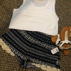 Charlotte Russe shorts! Brand new with the tag still on it. They are navy and white with cream colored lace at the bottom. The back on the waste band is stretchy and the front is not. Charlotte Russe Shorts