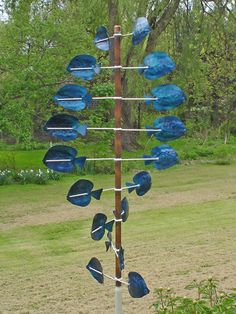 Blue Tang garden wind sculpture turns with the slightest breeze