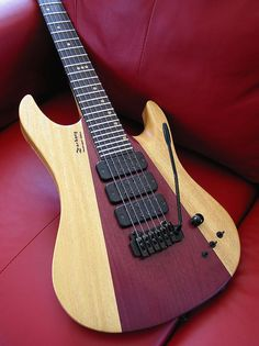 I think this is by the guy who made the cool axe out of the Ikea cutting board...  Love the purple heart wood #oneofakind #electric #guitar