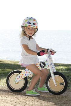 Pastel Dotty Kurve - balance bikes for kids: Modern and appealing curved styling Solid wooden wheels Upright posture similar to that of a regular bicycle Beautifully painted in funky pastel dotty design Matching Pastel Dotty helmet and Pastel Dotty gloves available  http://www.alltotstreasures.com.au/all-kids-treasures/kids-bikes-scooters/kurve-bike-kiddimoto