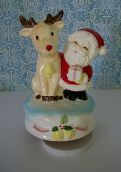 Vintage Sankyo Japan ceramic Santa and Rudolph music box plays Rudolph The Red Nose Reindeer.