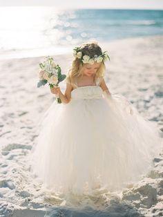 flower girl dress - photo by Lauren Kinsey http://ruffledblog.com/sophisticated-beach-wedding-at-edgewater-resort
