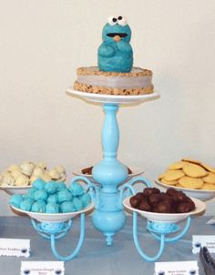 The cake stand was made from an old chandelier – so clever! Kelcie took the wires out and spray painted it aqua, then glued serving plates on with 9001 glue.