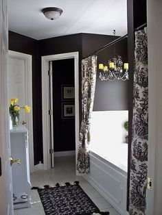 I never thought I'd like black walls but this bathroom makes it look great!