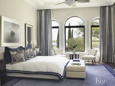 Contemporary White Bedroom with Shades of Blue - Luxe Interiors + Design