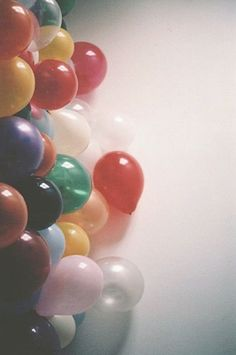 It'd be awesome to either have a wall of balloons, or just a bunch of balloons on the ground, with out strings...