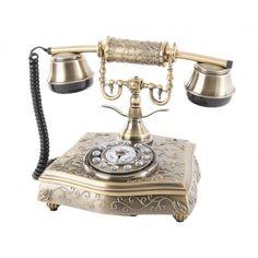 Teléfono antiguo dorado envejecido