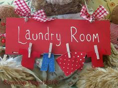 "CATH KIDSTON RED ""LAUNDRY ROOM"" SIGN."