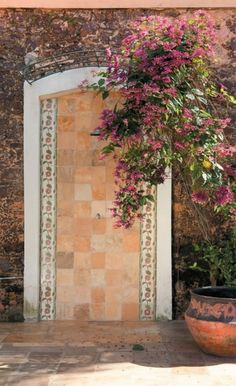 outdoor stone and tile detail with bougainvillea (or is that a trumpet vine) growing Perfect Peach, Outdoor Stone, Walled Garden, Colour Schemes, Color Palettes, Garden Plants, Garden Walls, Outdoor Projects, Outdoor Living