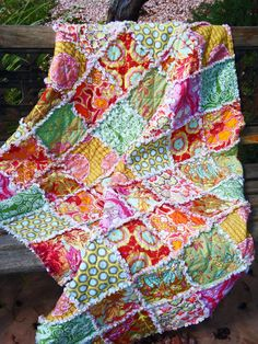 Rag Quilt, MODERN Lap Quilt, HANDMADE, Deep Tones of red, aqua, green and gold, florals, all NATURAL cotton, Designer Amy Butler. $120.00, via Etsy.