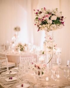 Tables topped centerpieces of alternating heights