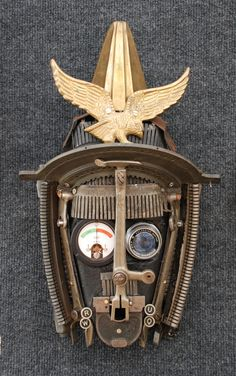 """""""Conquistador"""", Mask created by Assemblique™ from Wood, vintage  adding machine and typewriter parts, antique sewing machine parts, vintage camera lens, vintage gauges, & misc brass parts"""