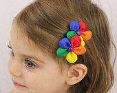 Rainbow Flower Hair Clip - Rainbow Petals - Rainbow Hair Bow Flower Girls Hair Bow - Rainbow Photo Prop. $10.00, via Etsy.