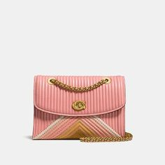 parker with colorblock quilting and rivets by COACH. Structured and lightweight, the Parker is a versatile bag that combines uptown elegance with downtown ease. It's crafted in quilted colorblock leather detailed with polished rivets, and finished with a Signature turnlock closure. Convert... #coach #bags