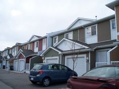 SOLD! Townhouse in Airdrie - walk out and backs on to walking path, next to shopping...what more could you want?