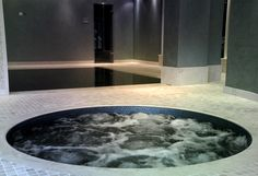 Manufactured a bespoke Bisazza tiled spa from Spa De La Mare, supplied and installed by Leisurequip