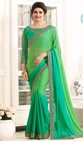 Prachi Desai Green Color Shaded Georgette Sari #indiansarees #designersarees Throw a spin to your overall looks draped in this Prachi Desai green color shaded georgette sari. The enticing lace and resham work all through saree is awe-inspiring. Upon request we can make round front/back neck and short 6 inches sleeves regular saree blouse also.  USD $ 86 (Around £ 59 & Euro 65)