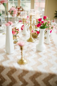 Glittering Pink and Gold Wedding Inspiration--very over the chevron, but the milk glass and flowers + gold sparkles is lovely.