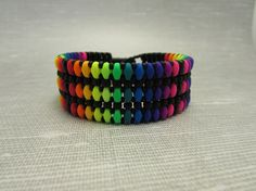 Woven Stacked Bracelet  Superduos in a Neon Rainbow by GnatsCrafts