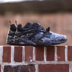 Designer: Puma Color: Black Limited Blaze of Glory ROXX from Puma Select. Printed leather and textile upper with a rubber sole and perforated detail.