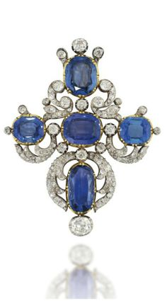 AN EARLY 19TH CENTURY SAPPHIRE AND DIAMOND BROOCH Of cruciform design, set with five vari-sized collet-set cushion shaped sapphires, among an old-cut diamond scrolling foliate surround, with further diamond collet accents, mounted in silver and gold, circa 1830, 7.0cm long, some later adaptations