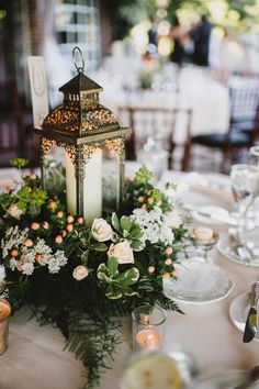 Wedding Table Decorations With Lanterns Greenery - romantic wedding centerpieces with candles Rustic Lantern Centerpieces, Romantic Wedding Centerpieces, Green Centerpieces, Rustic Lanterns, Bridal Shower Centerpieces, Wedding Lanterns, Wedding Table Centerpieces, Wedding Flowers, Wedding Decorations