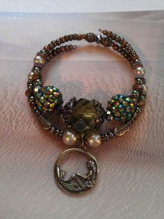 Under the Sea mermaid memory wire bracelet and by ABBGDesigns, $34.00