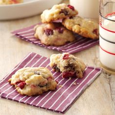 Cranberry Oatmeal Cookies Recipe -Dotted with cranberries, orange peel and vanilla chips, these cookies are so colorful and fun to eat. They look lovely on a dessert tray and would be a great addition to your Christmas cookie lineup. —Pat Habiger, Spearville, Kansas