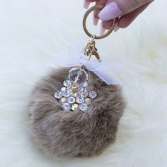 Tan Fur Ball Keychain Add an extra cute piece to your wallet or keys with this adorable and trendy keychain! This small furry poof has some rhinestones to glam it up and will get you compliments all day long! Comes in black and tan❤️  💸bundles 2+ items get 10% off ❤️Follow me on IG: @tanyakara_ 👻Follow me on Snapchat: @tanyakara Tanya Kara Accessories