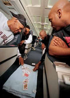 Iconic picture of the Bulls playing cards, maybe spades on the Plane.