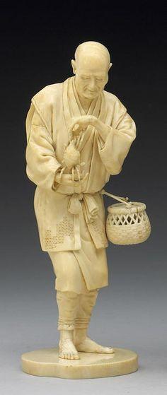 An ivory okimono of an elderly peasant Meiji Period, Signed Tomonobu