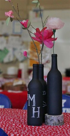 In phase 1 of making this for my friends wedding! Chalkboard paint - love this idea. Take an old glass bottle or wine bottle and spray paint chalk - then get creative.