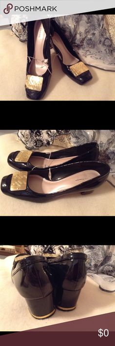 "Vintage Merona Black Patent Shoes, Size 10m This Is. nice Pair Of Merona black Patent Leather Shoes With Gold PlatesOn the Toes And A Strip Around Each Heel Are In Excellent Condition! A Few Dings In The Left heel and Side Not Noticeable From Storage! Love The Square Toe Of The Shoe Really Cute! The Heel Is 2"" ,Thanks! Merona Shoes Heels"